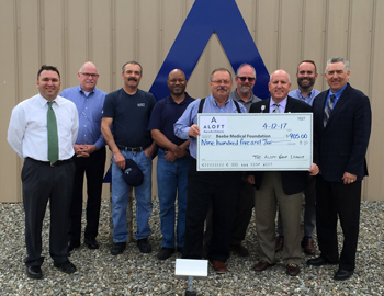 ALOFT presents check to Beebe Medical Foundation.