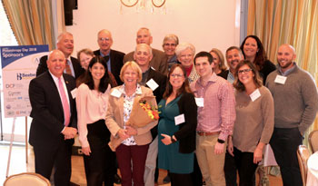 Shown is Judy Aliquo, center, at the awards ceremony surrounded by colleagues, friends and family. Shown in front (left to right) are Tom Protack, Vice President of Development, Beebe Medical Foundation; Tina DiSabatino, Alumni Director for Wilmington Fri