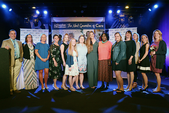 The award recipients and committee members pose for a photo at the 2019 Nursing Excellence Awards. Pictured left to right are: Chief Nursing Officer Steve Rhone, Laura Smith, award recipient Karen Pickard, award recipient Charlotte Buoni, award recipient