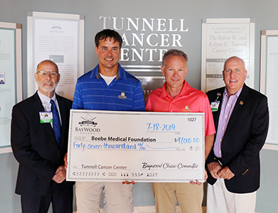 Barry Hamp, Executive Director of Beebe Healthcare's Oncology Services; Robert Tunnell III; Lincoln Davis, chair of Baywood Golf Classic; and Thomas J. Protack, Vice President of Development for the Beebe Medical Foundation.