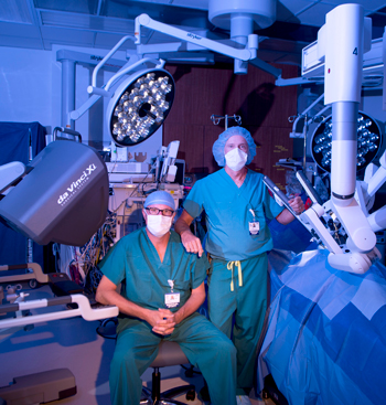 Dr. Kurt Wehberg and PA-C Ty Huskey have performed more than 500 robotically assisted surgeries each.