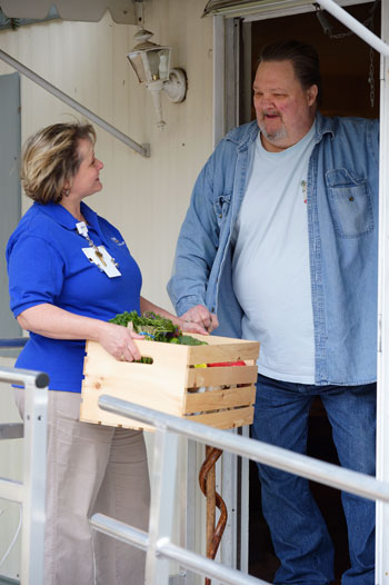 Catherine Murphy, Beebe Population Health, delivers food