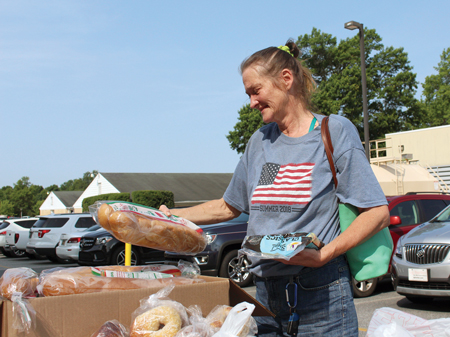 Debbie selects food during the monthly Beebe Prescription Food Program.