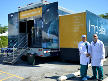 Dr. Ivan Pena Sing and Dr. Mouhanad Freih in front of the Impella Mobile Learning Lab.