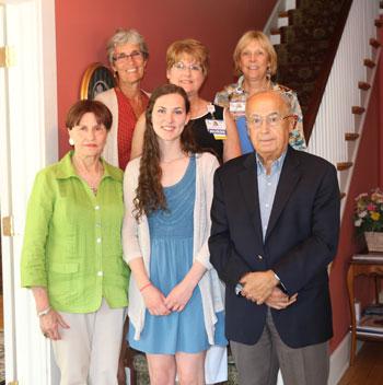Angela Baker receives Saliba Scholarship check