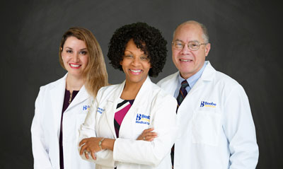 Shown are Dr. Samaneh Dowlatshahi; Dr. Karen Smith Coleman; and Dr. Carlton Boxhill.