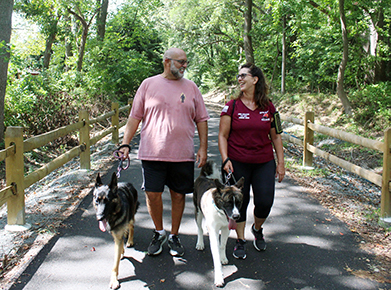 John and Laura Epstein enjoy walking their dogs, Bella and Shiro, along the Lewes-Georgetown trail since his successful hip replacement surgery at Beebe.