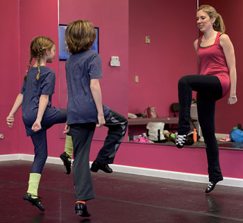 Dr. Erin Fletcher, DO, and children during Irish Dance class.