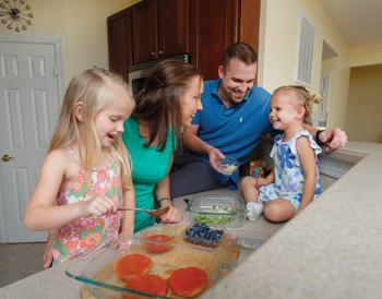 Dr. Farrell and family preparing dinner.