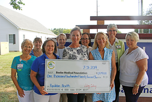 Shown are Mary Summerville, RN; Barbie Robets, Administrative Secretary; Catherine Murphy, MSN, RN; Stephanie Williams, RN, Kim Blanch, RN, Community Services Manager; Kathi Fryling, Food Services; Valery Cordrey, of East Coast Garden Center; Diane Barlow