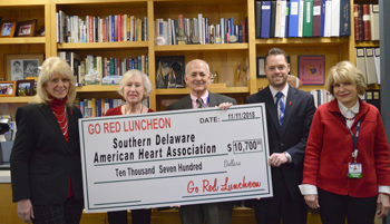 Shown during the check presentation (left to right) are Karen Gritton, development director, American Heart Association in Southern Delaware; Pat Sandy, co-chair of the Go Red Luncheon; Mr. Fried, Beebe Healthcare; David Morris, executive director, Americ