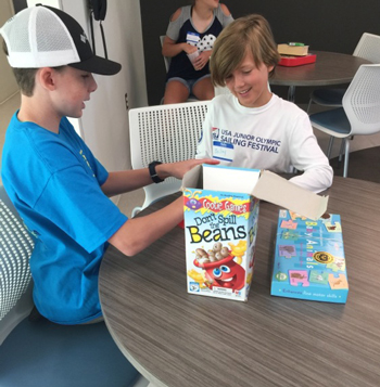 Aiden Bowman and Bailey Fletcher practice playing board games on their lunch break