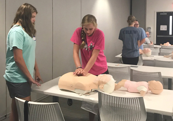 Students practice newly mastered CPR skills