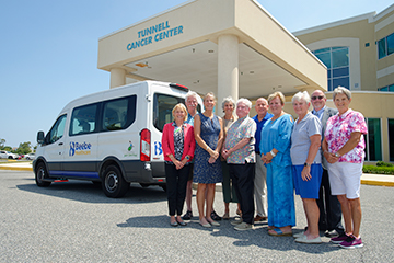 At the Tunnell Cancer Center are (l-r) Beebe Medical Foundation President and CEO Judy Aliquo, David Mann, Vicki Tull, Diane Barlow, Jim Martin, BMF Vice President of Development Tom Protack, Cherrie Rich, Judy Wetzel, Rick Schaffner, and Ruth La