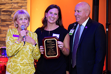 Judy Aliquo, President & CEO, Beebe Medical Foundation, awards Katie Johnson, DO, Medical Director of Palliative Care, the 2019 Philanthropy award as Tom Protack, Vice President, Beebe Medical Foundation, looks on Thursday, Oct. 3 at the Fairfield Inn & S