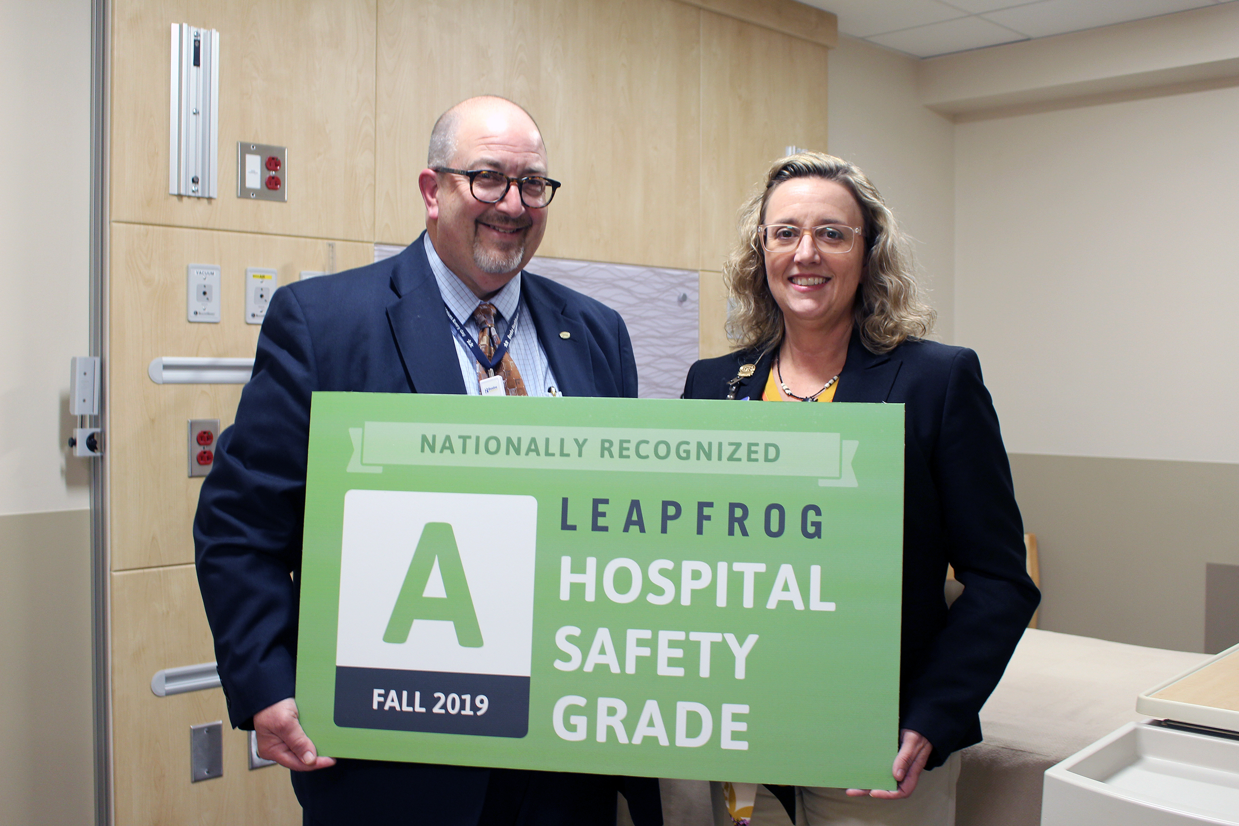 "Rick Schaffner, Interim CEO, Executive Vice President, and COO, stands with Marcy Jack, JD, BSN, CPHRM, Vice President and Chief Quality and Safety Officer, after Leapfrog awarded Beebe Healthcare an ""A"" for quality and safety."