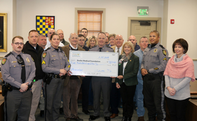Shown (left to right) are:  In front: Ellen Lorrane, Tyrone Woodward, Rich Schazza, Judy Aliquo, Tom Protack, Chief Thomas Spell, Jeff Fried, Sherri Harmon, Jim Azato, and Anthony Vallenti. In back are Chatham Marsch, Casey Crapps, Jamie Locklear, Jonatha