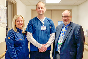 Gavin Zakarevicz, RN, (center) is the recipient of Beebe Healthcare's May 2019 L.O.V.E. Letter. Also pictured are Loretta Ostroski, Director of Patient Care Services, left, and Rick Schaffner, Interim CEO, Executive VP & Chief Operating Officer.
