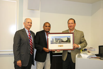 Dr. Peri presented with framed photograph by Mr. Fried and Dr. Peet