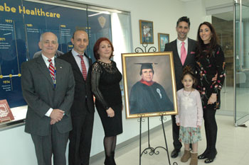 Mr. Fried, Dr. Helou, Shirin Saberi & Saberi children gather around Dr. Mansour Saberi's Memorial Portrait