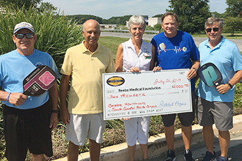 Pictured left to right: Steve Costa, Coastal Communities Pickleball League; Mike Smith, Co-Captain Team Cancer; Diane Barlow, Beebe Medical Foundation Gift Planning Officer; Stan Piesla, Coastal Communities Pickleball League, and Steve Melofchik, Captain