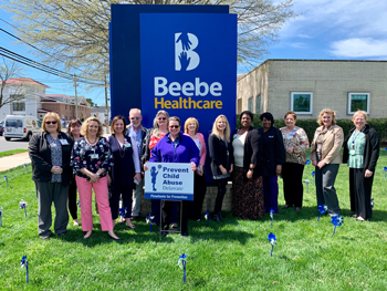 Beebe Healthcare employees gathered on Tuesday, April 16, to plant pinwheels on the front lawn of the Margaret H. Rollins Lewes Campus to recognize Child Abuse Prevention Month.