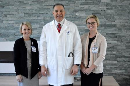 Beebe Medical Staff presents scholarship to nursing student.