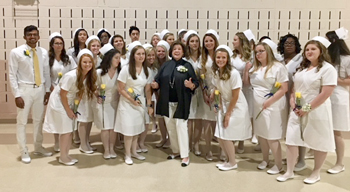 The Margaret H. Rollins School of Nursing class of 2018 celebrates with Peggy Rollins at the ceremony. In 2011, Randall and Peggy Rollins donated $3 million through their Ma-Ran Foundation toward the expansion and naming of Beebe Healthcare's Margaret H.