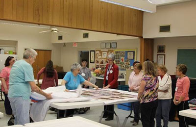 Shirley Loveland and the quilting group