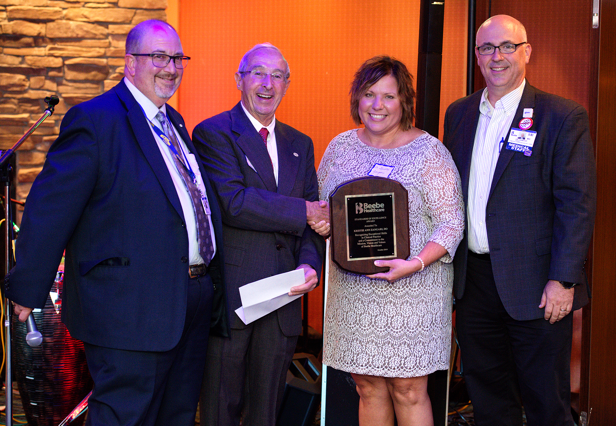 Shown during the physician award presentation, left to right, are Rick Schaffner, Interim CEO, Executive Vice President, and COO; David Herbert, Chair of Beebe Board of Directors; Kristie Zangari, DO, and Jeffrey Hawtof, MD, VP of Medical Operations.