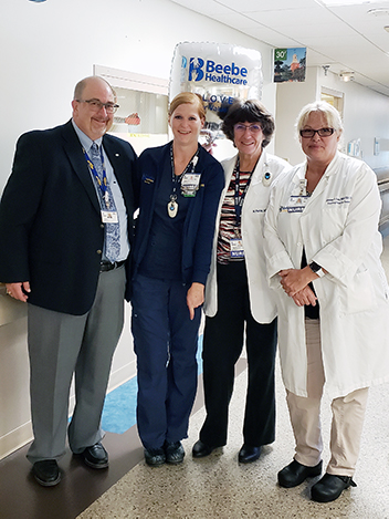 Dareth Penuel, RN (second from left) is the recipient of Beebe Healthcare's August 2019 L.O.V.E. Letter. Also pictured from left to right are Rick Schaffner, Interim CEO, Executive Vice President and Chief Operating Officer; Margaret Porter, RN, Nurse Man