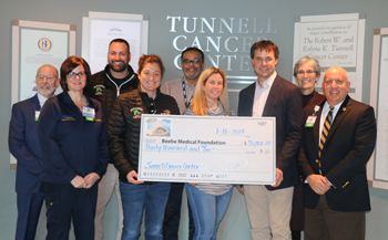 Pictured left to right: Barry Hamp, Executive Director, Oncology Services; Lisa Henderson, RN, Nurse Manager, Tunnell Cancer Center; Al Tortella, Owner, Tortella Enterprises, Paradise Grill; Sandy Samsel, Controller, Tortella Enterprises, Paradise Grill;