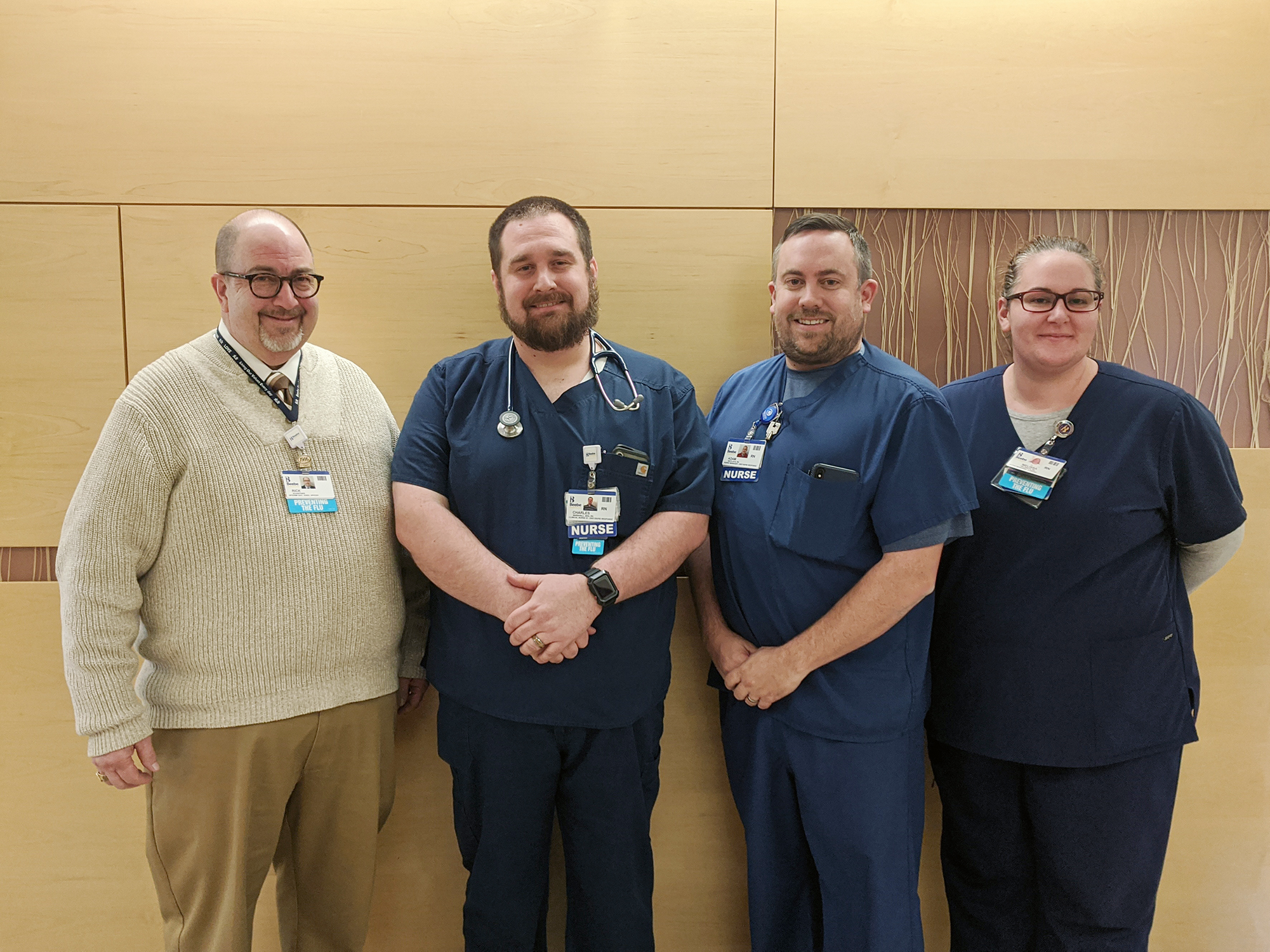 CJ Marshall (second from left), Emergency Department Clinical Team Leader at Beebe Healthcare, is the recipient of Beebe's January L.O.V.E. Letter. Also pictured from left to right are Rick Schaffner, Interim CEO, Executive Vice President, Chief Operating