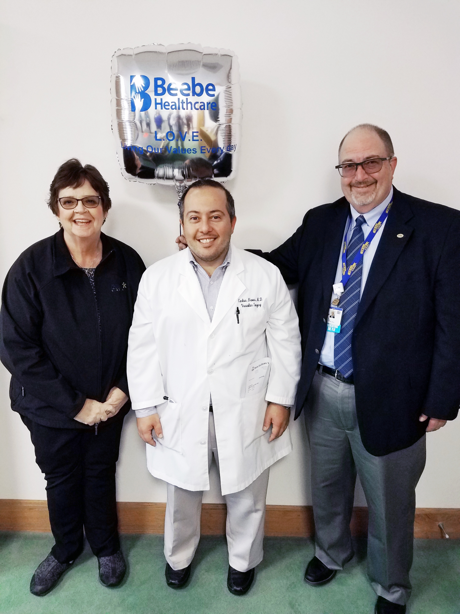 Carlos Neves, MD, Vascular Surgeon at Beebe Healthcare, is the recipient of Beebe's November 2019 L.O.V.E. Letter. Also pictured are Catherine Walls, Patient Experience Coordinator, and Rick Schaffner, Interim CEO, Executive Vice President, Chief Operatin