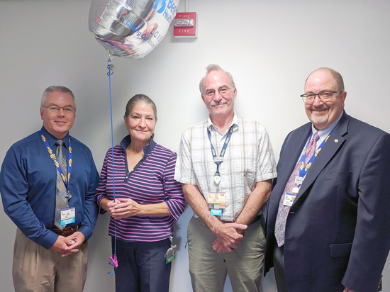 Tina Flatch is the recipient of Beebe Healthcare's October 2019 L.O.V.E. Letter. Also pictured from left to right are Clint Perkinson, Director of Information Services; Brad Travis, Technology Manager; and Rick Schaffner, Interim CEO, Executive VP