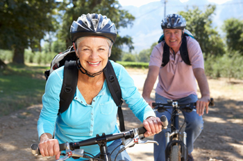 Stay safe this summer by wearing helmets when bicycling.