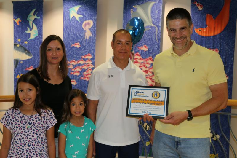 Linda and John Kopf, with their daughters, Kaitlyn and Sarah, celebrate John's excellent care provided by Dr. Erik Stancofski, right, and Beebe's Same-Day Surgery Team.