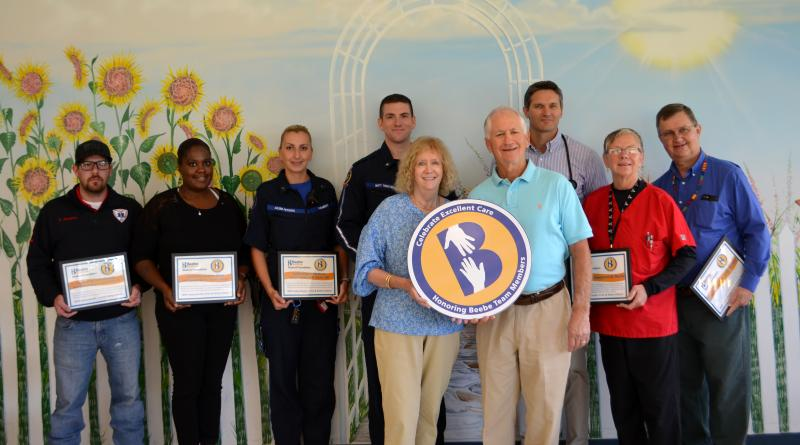 Ernie and Kathy Catucci, in front, celebrate excellent care with (l-r) Justin Shockley and Christine Mapp of Mid-Sussex Rescue Squad Station 91; Kalina Petkova and Matt Troutman of Sussex County EMS Medic 106; Dr. G. Robert Myers, interventional cardiolog