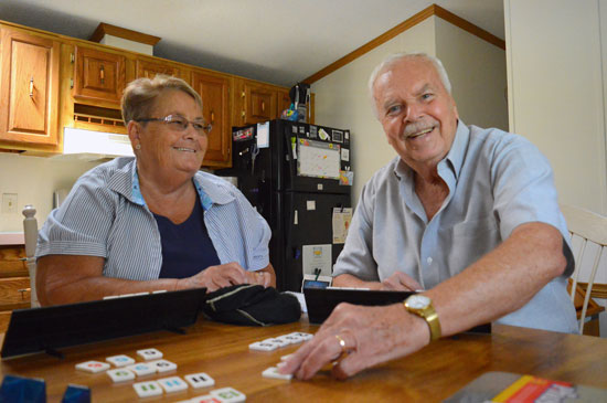 Charley and Mary Senick enjoy playing Rummikub at home after Charley's lung surgery.