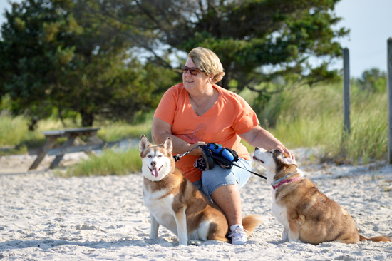 Dee Cole enjoys walking her dogs on the beach south of Dewey.