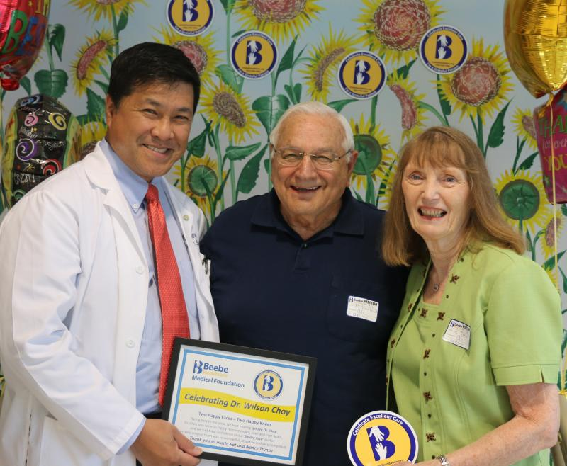 Celebrating Excellent Care with Orthopaedic Surgeon Dr. Wilson Choy, left, are grateful patient Pat Trunzo and his wife Nancy Trunzo.