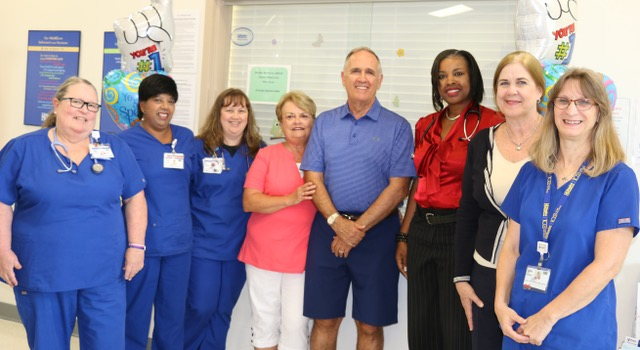 Celebrating Excellent Care are (l-r) Lynn Dalrymple, RN; Saleicha Baksh; Amber Holland, CNA; Sharon and John Kennedy; Karen McGibbon, MD; Barbara Peterson; and Karen Bryner.