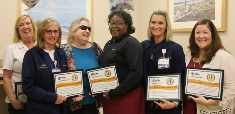 Nan Strange celebrates her excellent care with the Tunnell Cancer Center Team. Shown are (l-r) Debbie Crowell, RN; Nancy Burd, RN; Nan Strange; Gina Knapp, CCA; Leks Howard, RN; and Kathy Cook, MSN, RN.