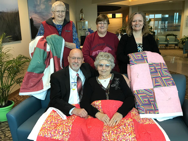 Shirley and the Quilt Group with Barry Hamp at Tunnell Cancer Center.