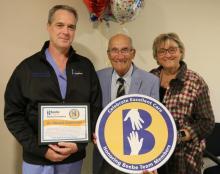Tom Volatile and Carol Dennis celebrate the excellent care Tom received from Dr. Edward Stephenson, left.