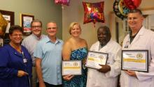 Celebrating Excellent Cardiac Care are (l-r) Moira Quint, office coordinator; David Nelson and Bill McManus; Dawn Snyder, RN-ICU; Dr. M. Ray Kuretu, cardiothoracic surgeon; and Brian McCarthy, PA-C.