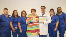 Kathy Plumley of Frankford, center, celebrates Dr. Harry Anagnostakos and his excellent care for her colonscopy along with team members from Beebe Gastroenterology Associates (l-r) Sean Mayhew, Dee Thiess, Donna Pennypacker, Melody McCleaf, and Georgetta