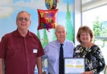 Joe and Linda Komorowski celebrate excellent care with Dr. Mayer Katz, center.