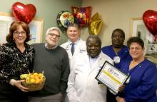 Lorraine and Mike Messitt stand with the Beebe Cardiac Surgery team, Brian McCarthy, PA-C, Dr. M.L. Ray Kuretu, Moira Quint and Robert Capers.